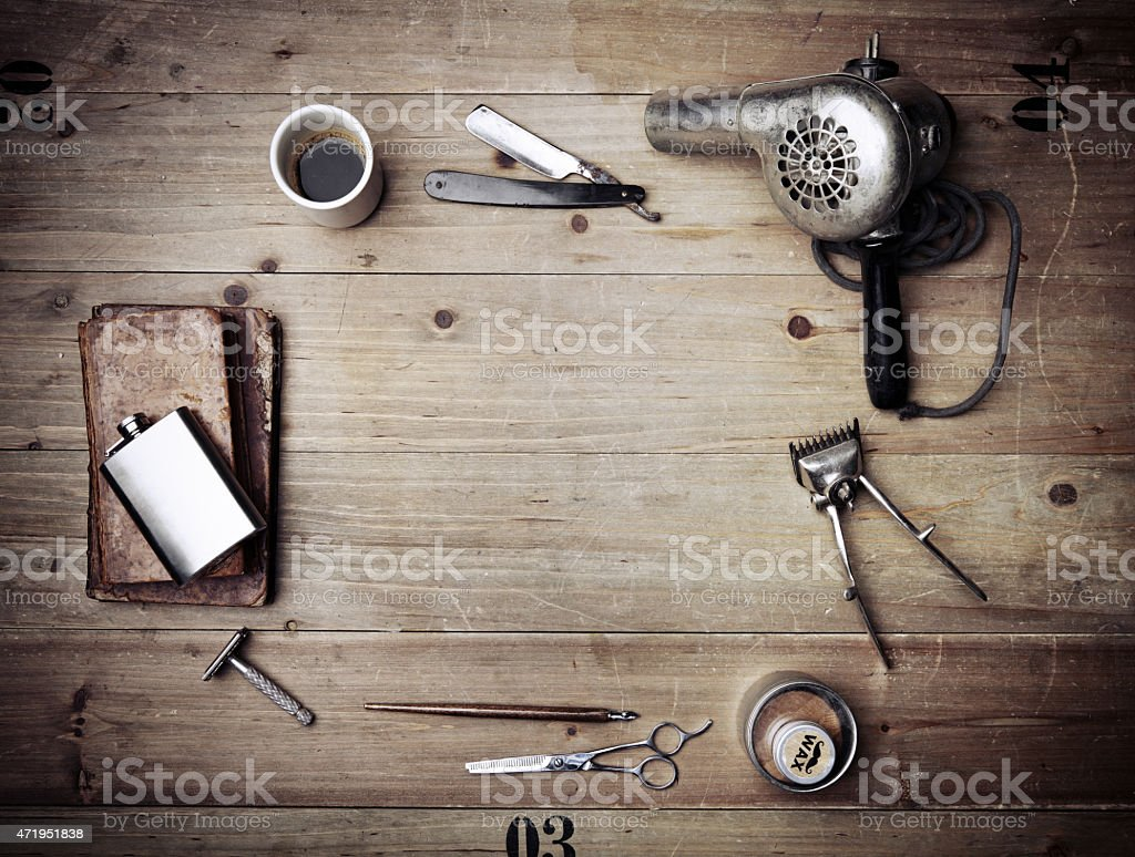 Vintage barber shop equipment on wood background stock photo