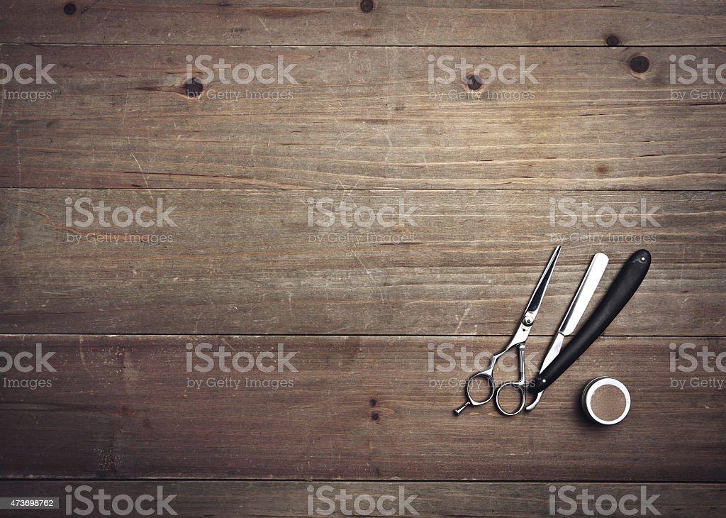 Vintage barber tools on wood background stock photo