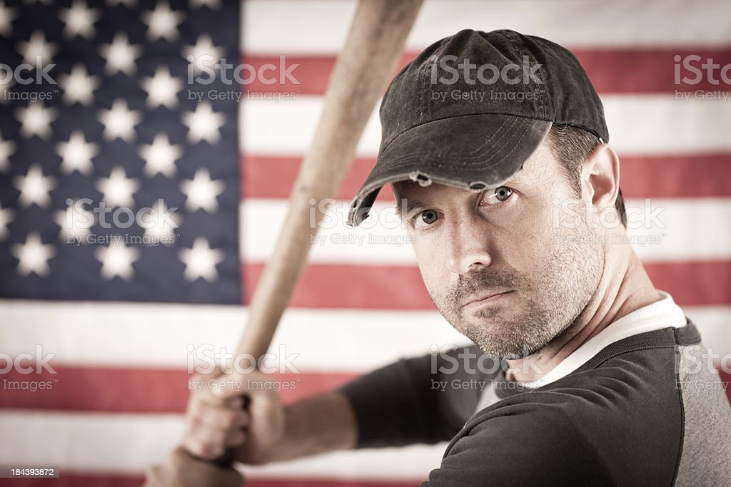 Vintage Baseball Player by American Flag royalty-free stock photo