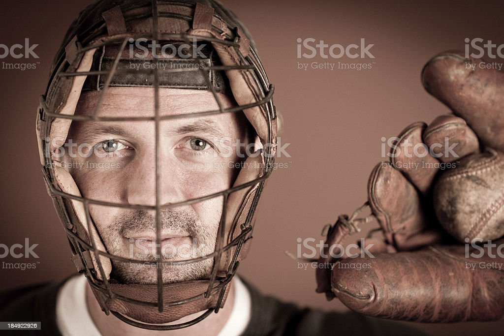 Vintage Baseball Player in Catching Stance with Ball and Mitt royalty-free stock photo
