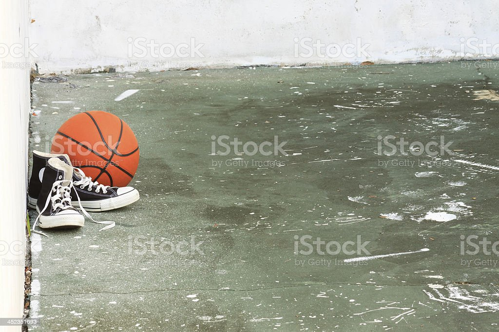 Vintage Basketball Shoes and Ball In Inner City Playground stock photo