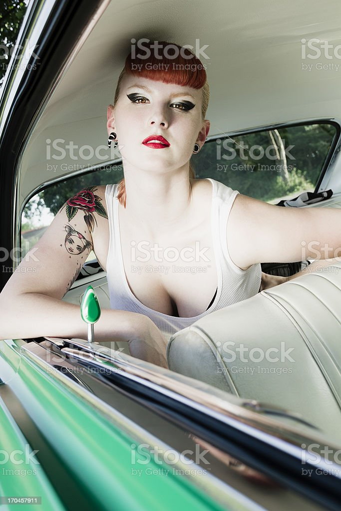 Vintage beauty in a car royalty-free stock photo