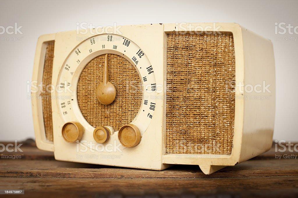 Vintage Beige and Tan Radio Sitting on Wood Table stock photo