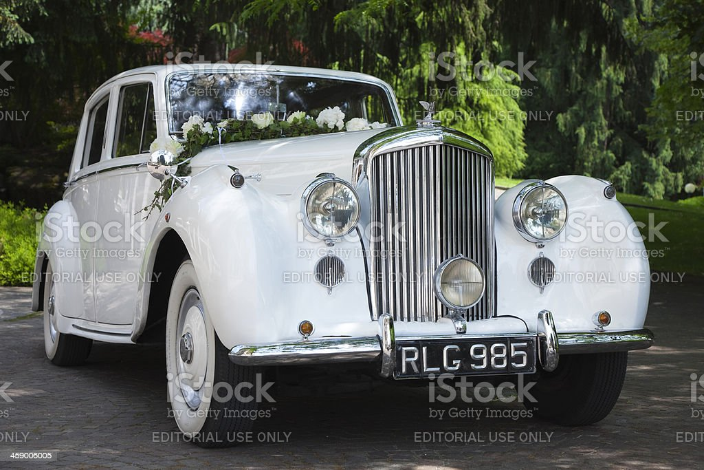 Vintage Bentley Wedding Car Decorated with Flowers stock photo
