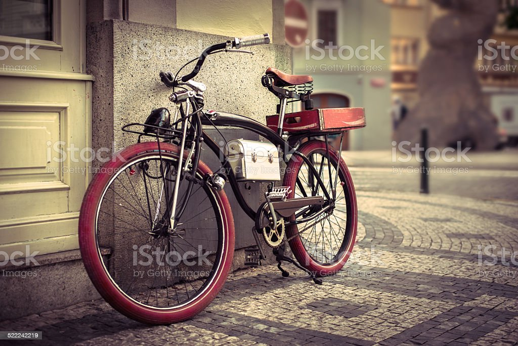 Vintage bicycle at the city stock photo