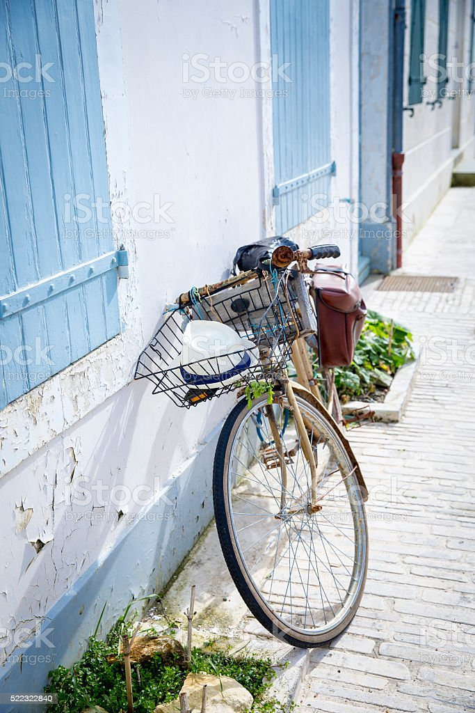 vintage bike in front of seaside house stock photo