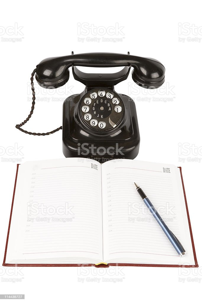 Vintage black phone, pen and open organizer with empty pages royalty-free stock photo