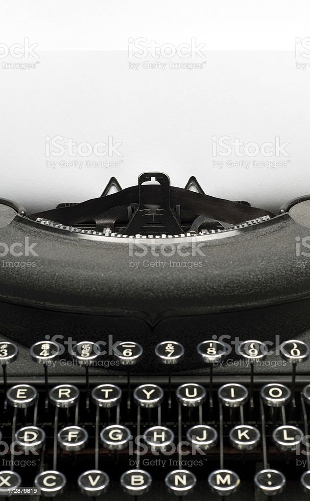 Vintage black typewriter w/paper for text stock photo