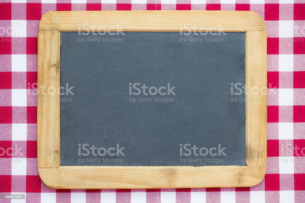 Vintage blackboard on gingham royalty-free stock photo