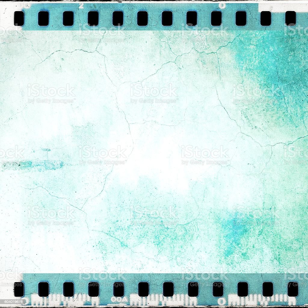 Vintage blue cracked film strip frame stock photo