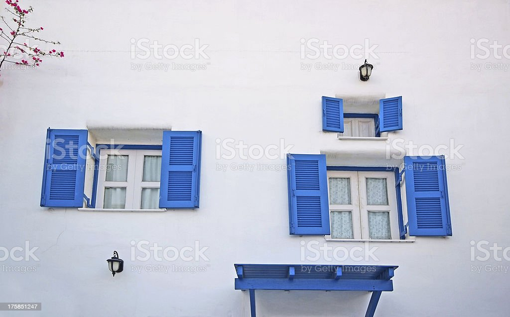 Vintage blue windows on the wall stock photo