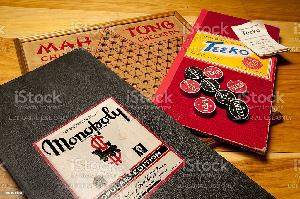 Vintage Board Games Including Monopoly, Teeko, and Chinese Checkers royalty-free stock photo
