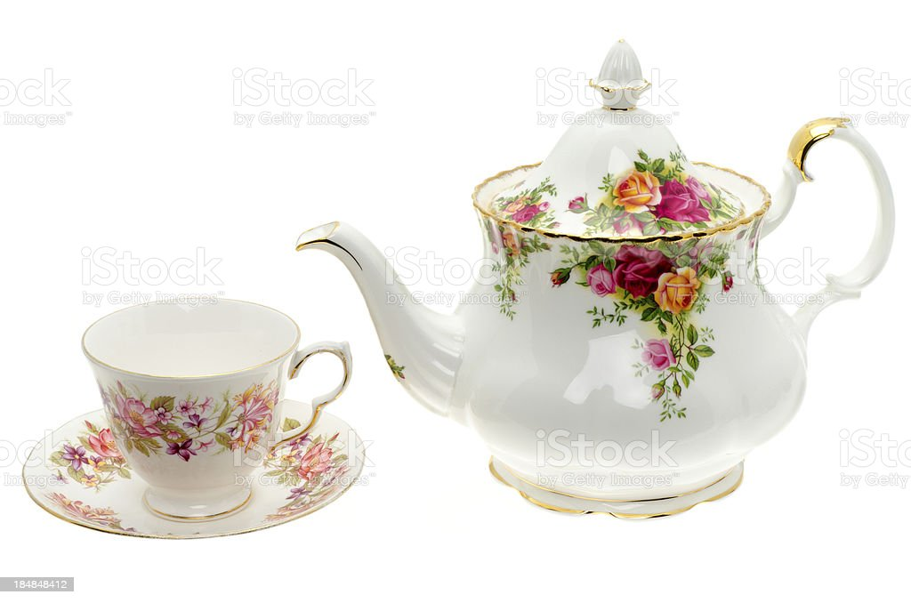 Vintage bone China teapot with a cup and saucer stock photo