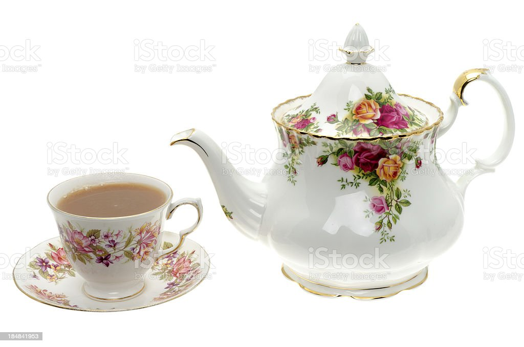 Vintage bone China teapot with a cup of tea. stock photo