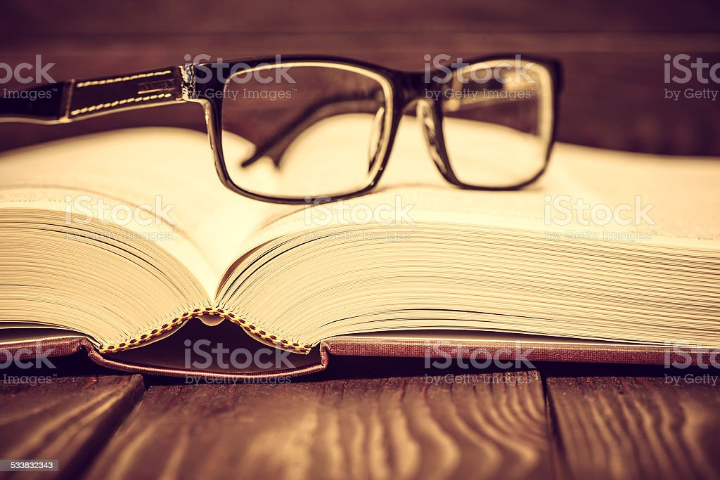 Vintage book on wooden background stock photo