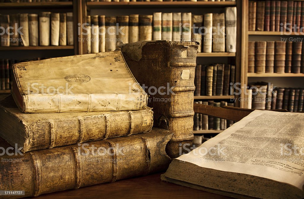 Vintage books in a library stock photo