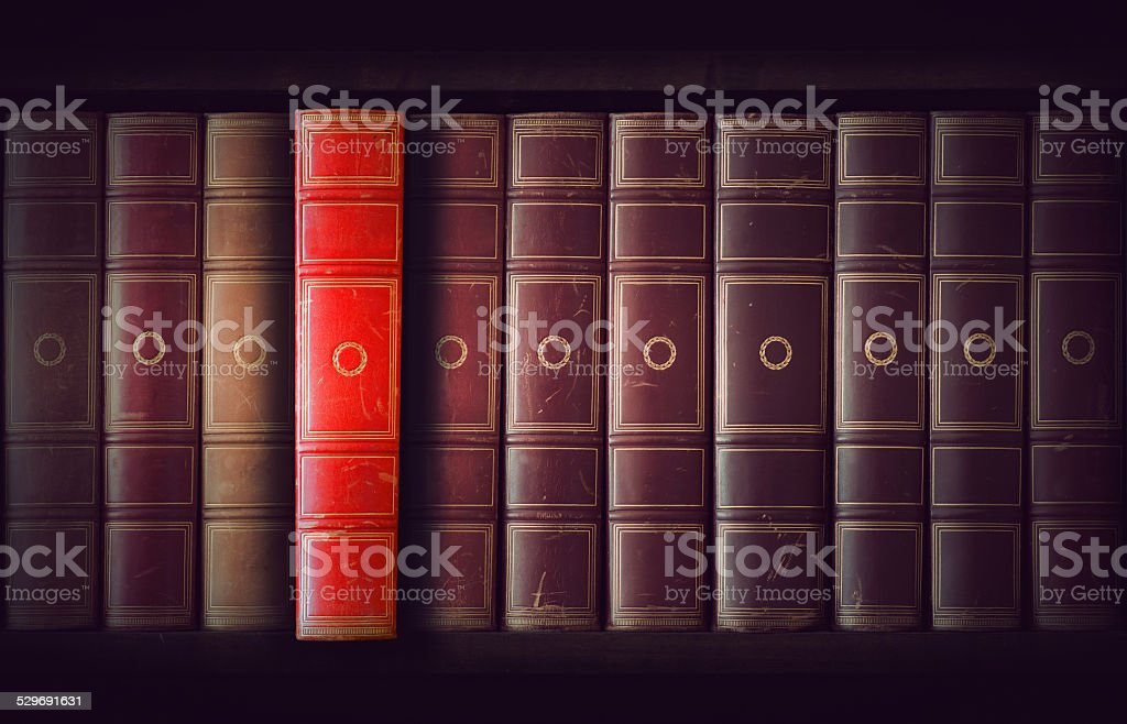 Vintage books in bookcase stock photo