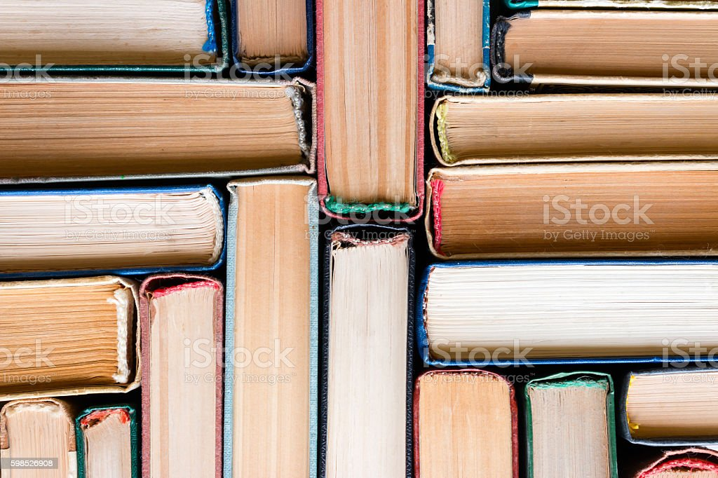 Vintage books in hardcover close-up top view stock photo