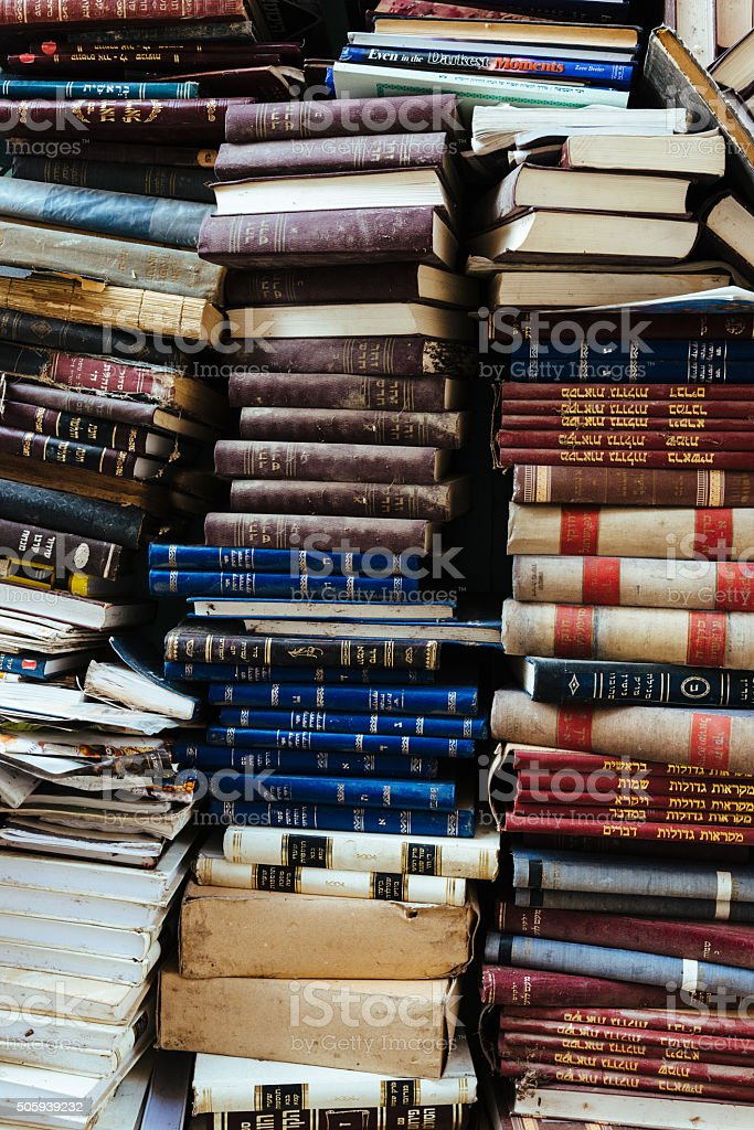 Vintage books on library or bookstore shelf in Hebrew language stock photo