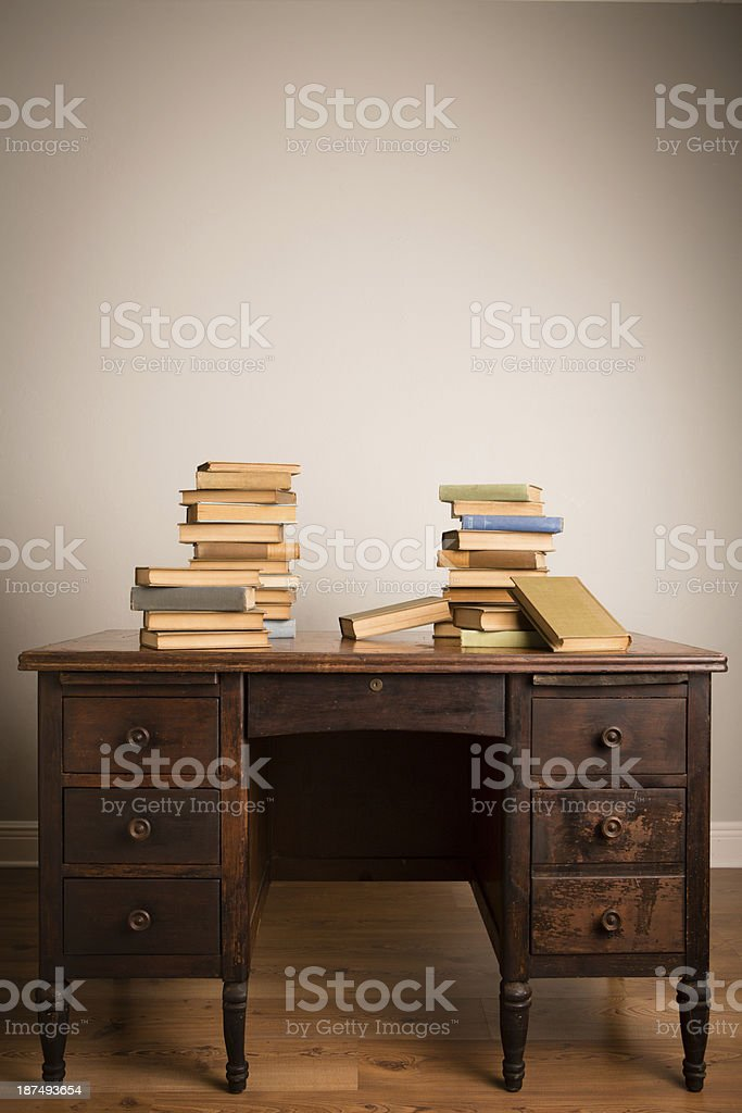 Vintage Books Sitting on Antique Desk, With Copy Space stock photo