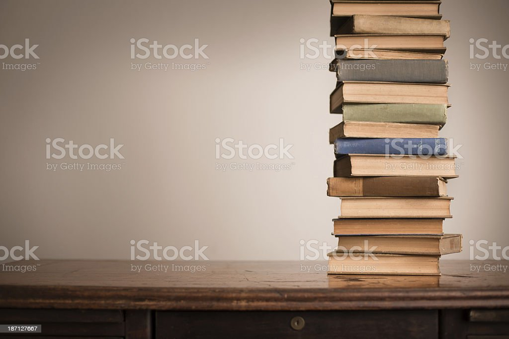 Vintage Books Sitting on Old Desk, With Copy Space royalty-free stock photo