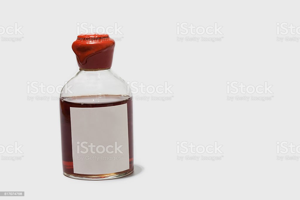 Vintage bottle with red wax cork, brown booze and blank stock photo