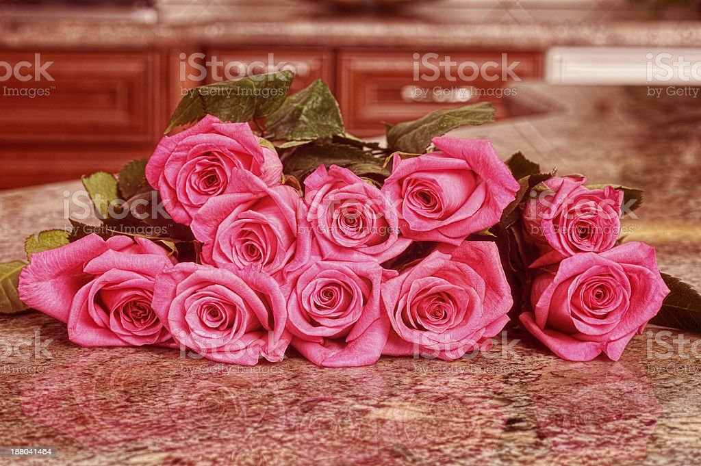 Vintage Bouquet Of Roses Laying On A Granite Kitchen Countertop royalty-free stock photo