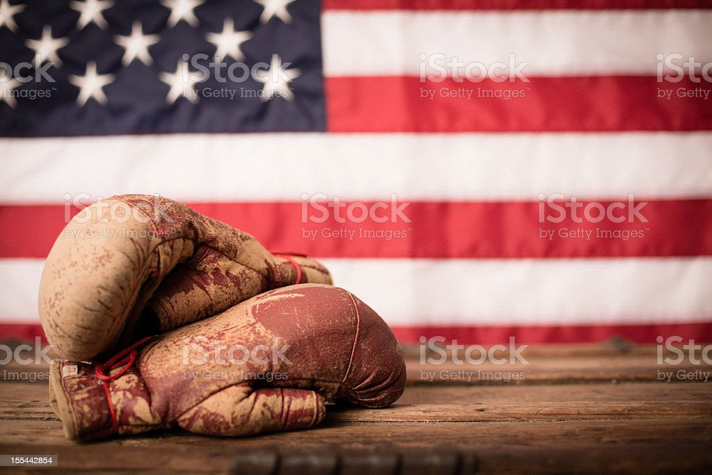 Vintage Boxing Gloves in Front of American Flag stock photo