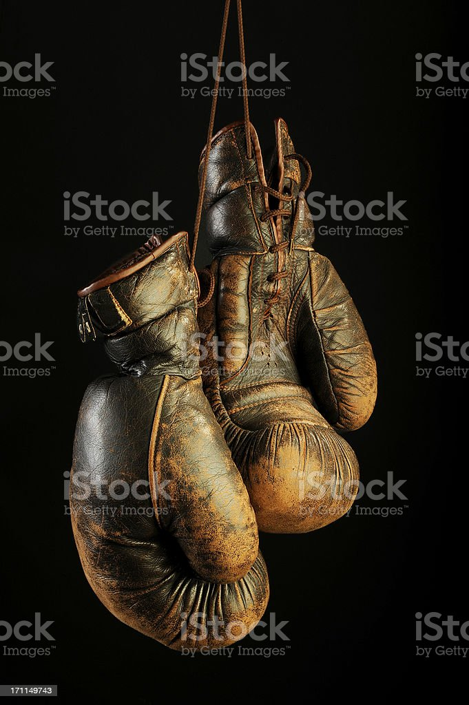 Vintage beaten,decayed boxing gloves on black background