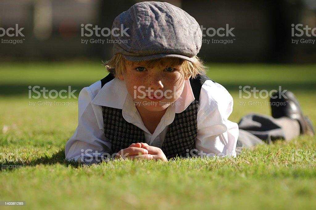 vintage boy on grass stock photo