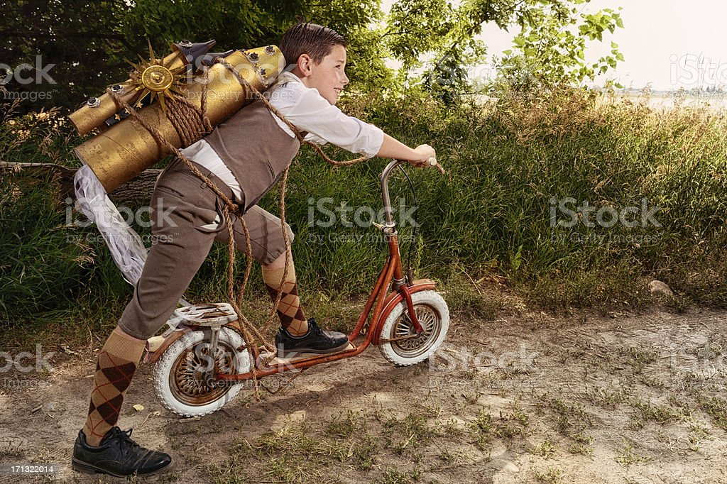 Vintage Boy With Toy Space Rocket & Scooter - Imagination royalty-free stock photo