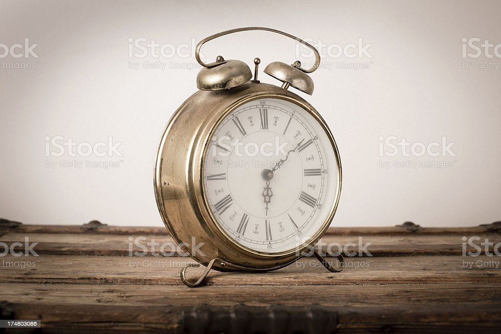 Vintage Brass, Footed Alarm Clock,Sitting on Wood royalty-free stock photo