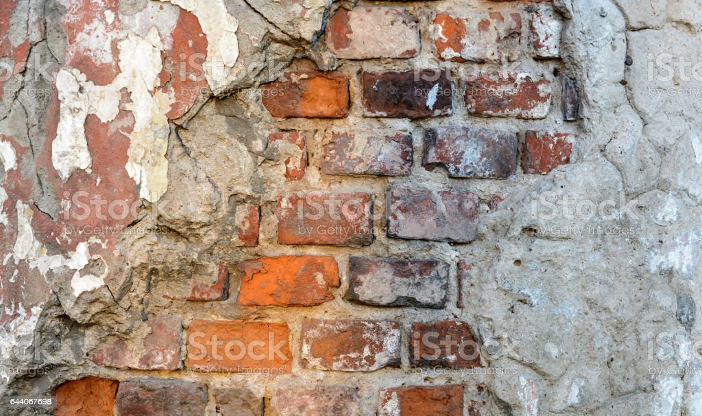 Vintage brick rough rustic wall with damaged plaster stock photo