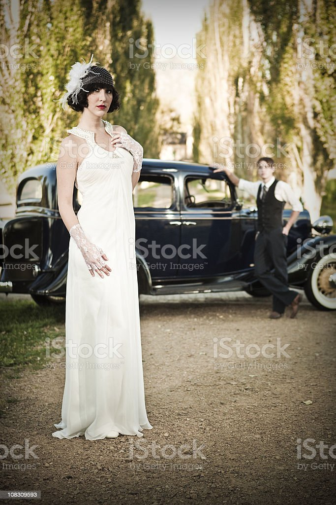 Vintage Bride and Groom with Antique Automobile stock photo