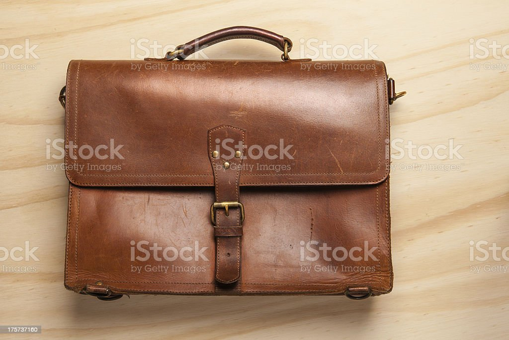 Vintage Briefcase on wood background royalty-free stock photo