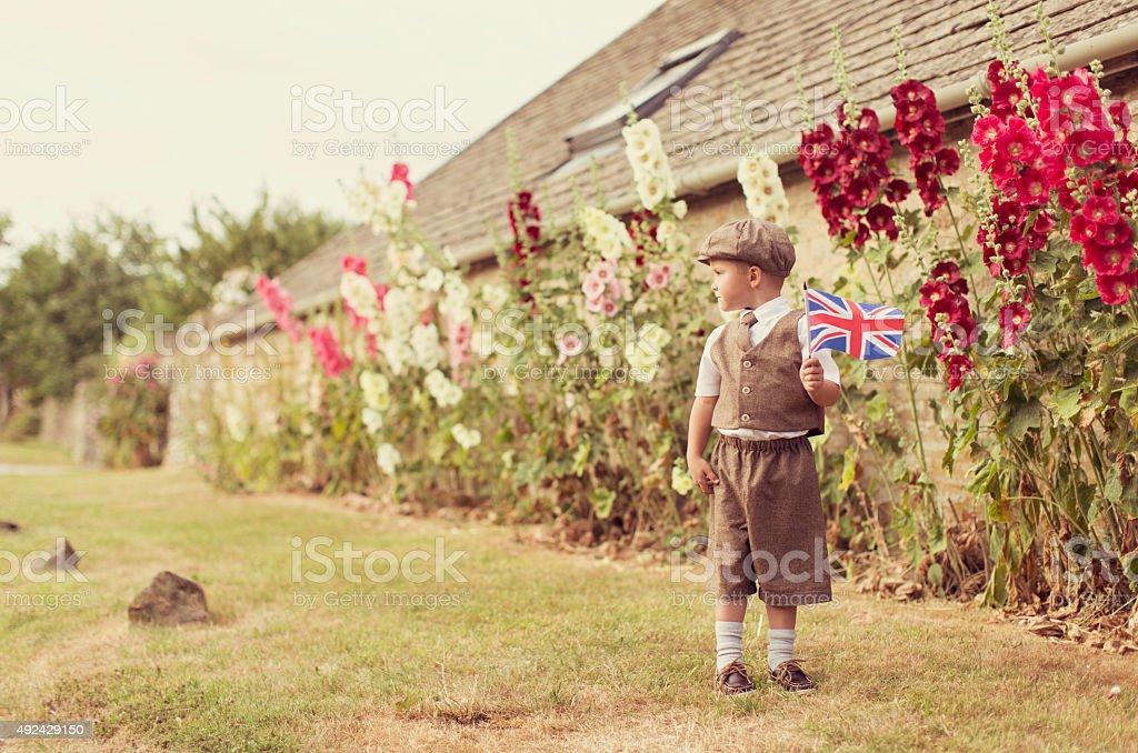 Vintage British Boy Standing With Union Jack stock photo