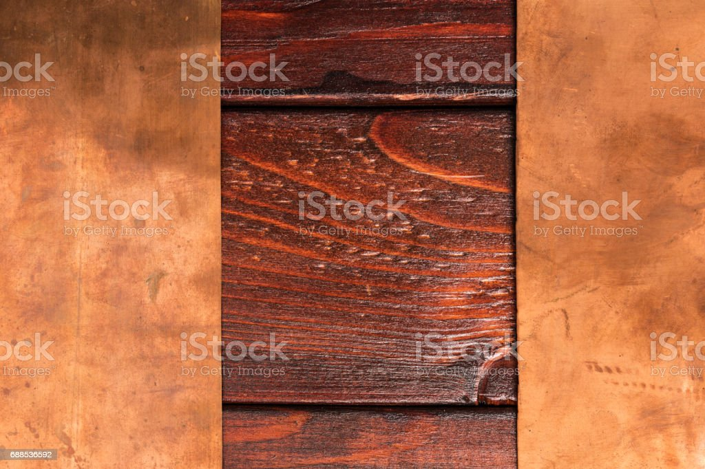 Vintage bronze and wooden background stock photo