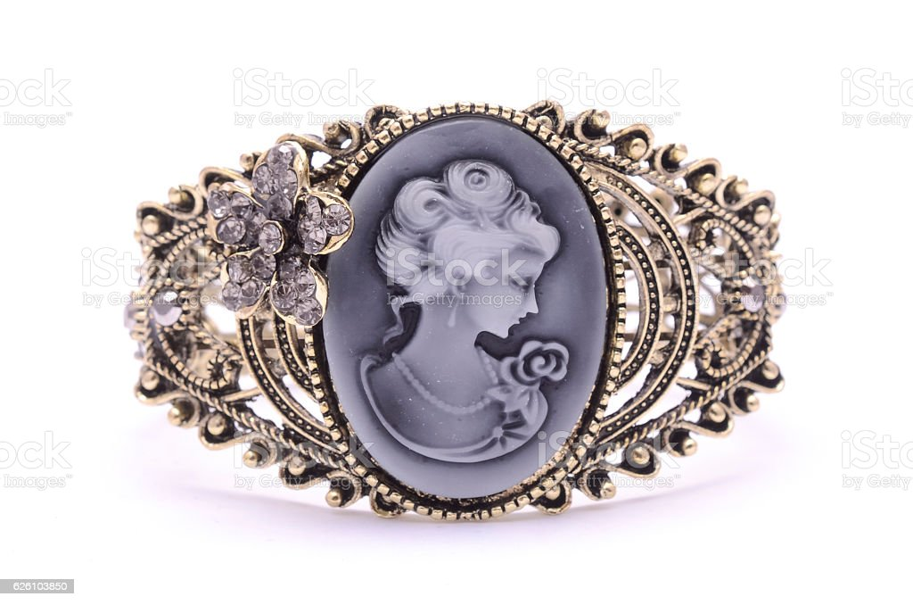 Vintage brooch isolated on white stock photo