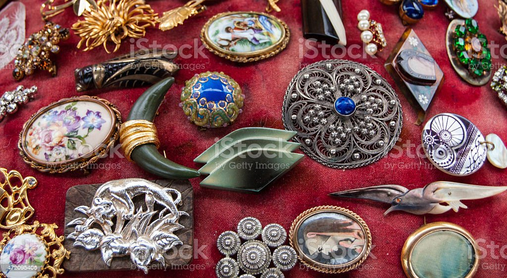 Vintage brooches for sale at flea market in Paris, France. stock photo