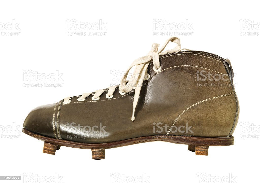 Vintage brown football shoe with pegs stock photo
