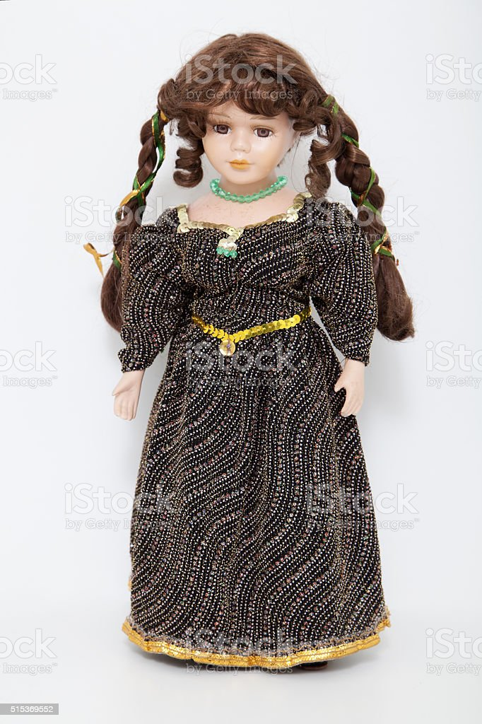 Vintage brown hair doll in elegant dress stock photo