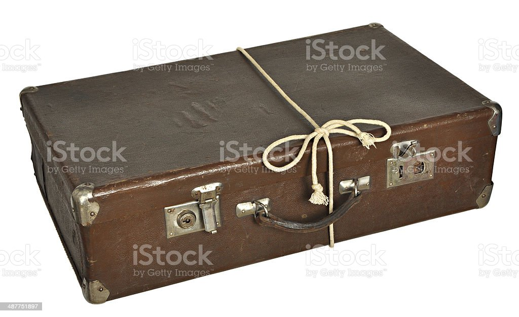 Vintage brown suitcase isolated on white background royalty-free stock photo