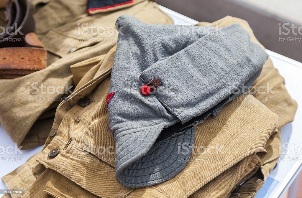 Vintage budenovka (wool cavalry helmet) used as uniform stock photo