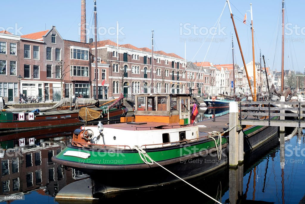 Vintage buildings and masts of ships in Rotterdam stock photo