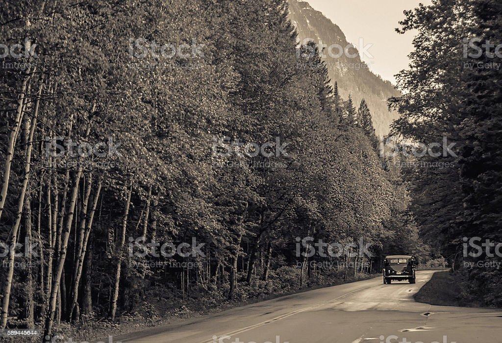 Vintage Bus in Glacier National Park stock photo