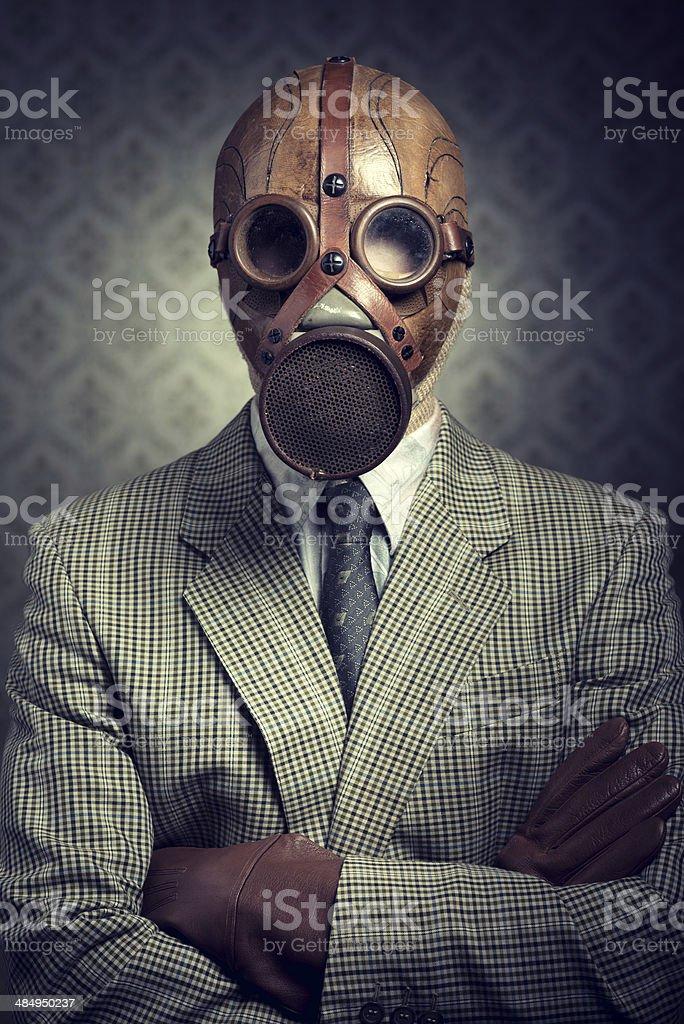 Vintage businessman wearing gas mask stock photo