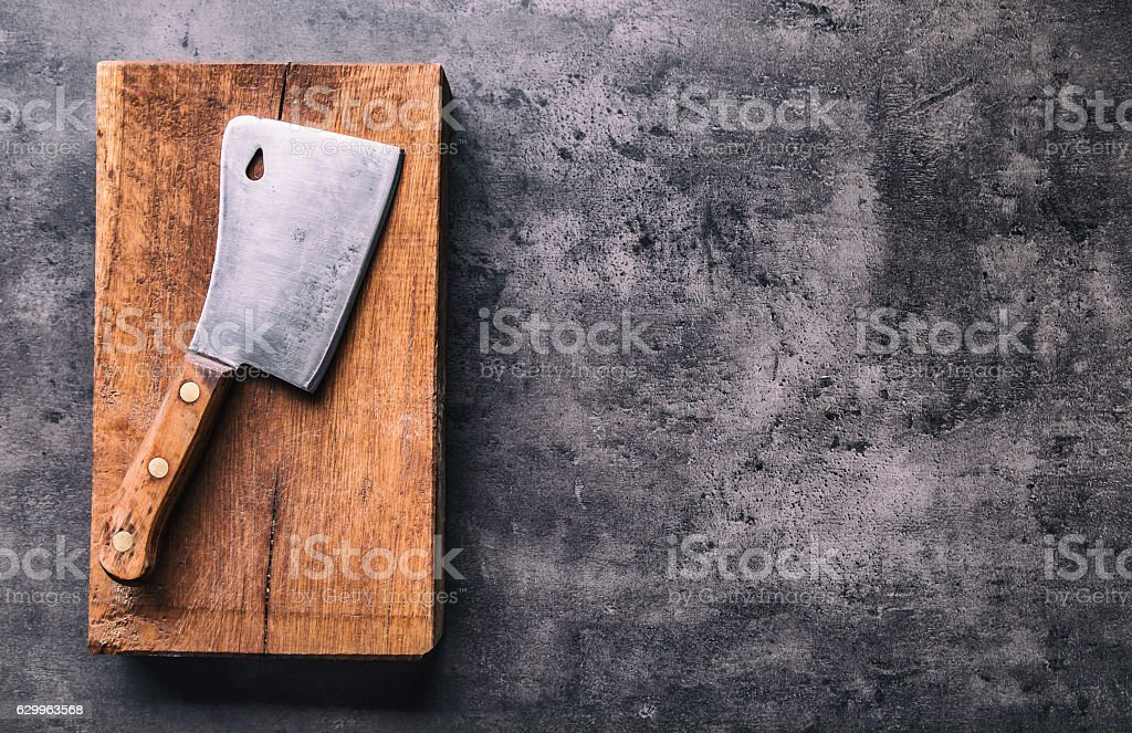 Vintage butcher meat cleavers on concrete or wooden board. stock photo