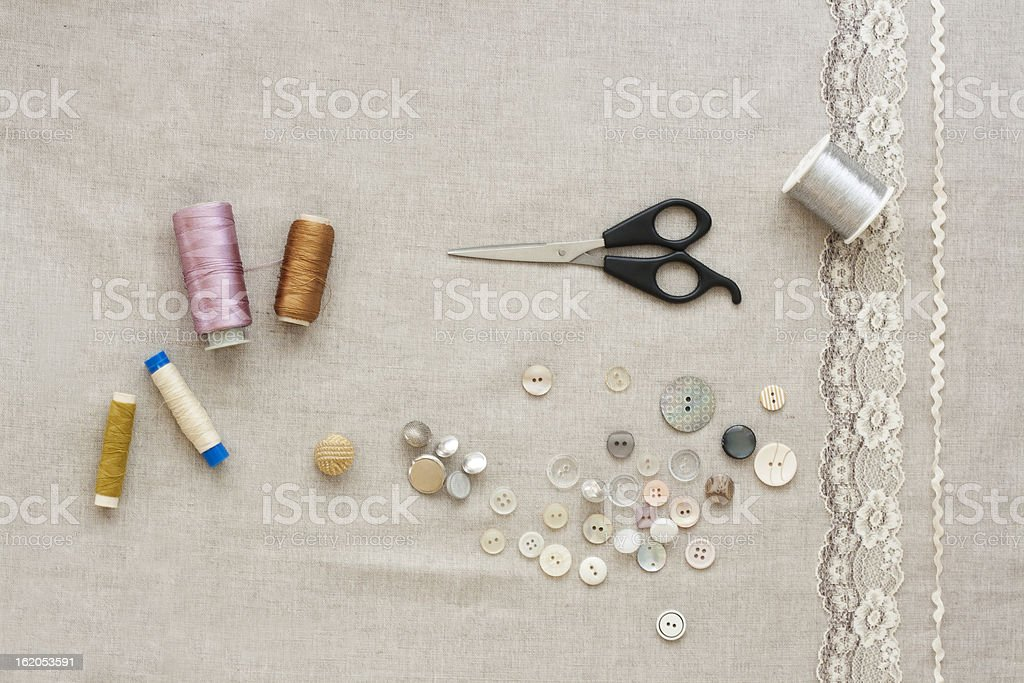 Vintage buttons with scissors, lace, ribbon stock photo