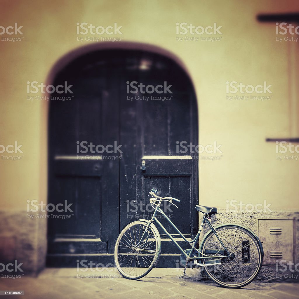 Vintage Bycicle leaning on the Wall in Italy royalty-free stock photo