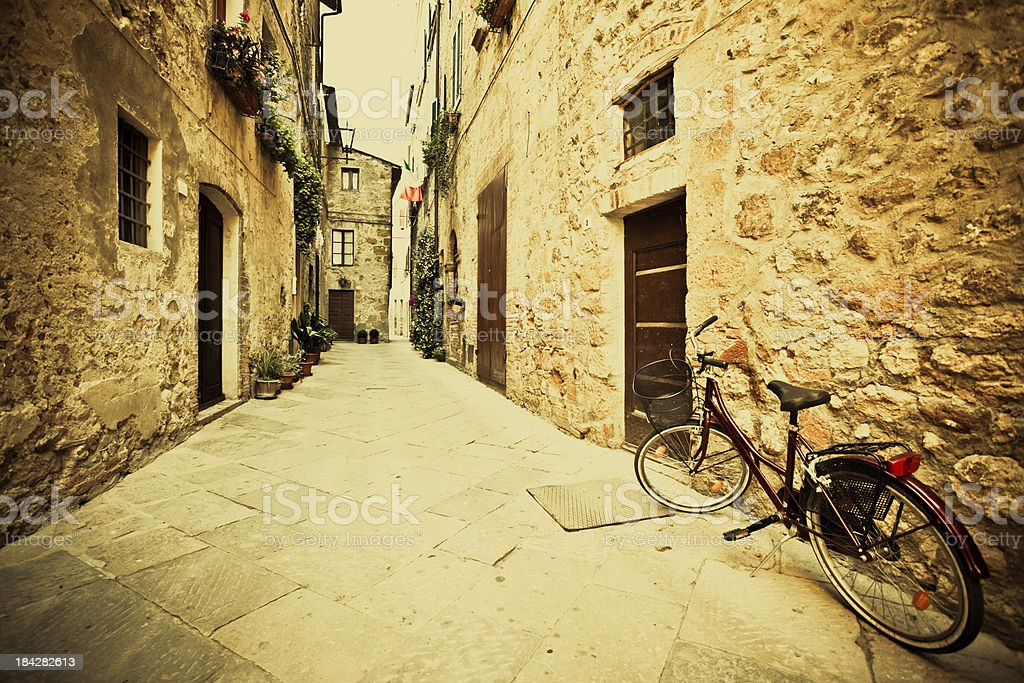 Vintage Bycicle leaning on the Wall in Tuscany Village, Italy royalty-free stock photo